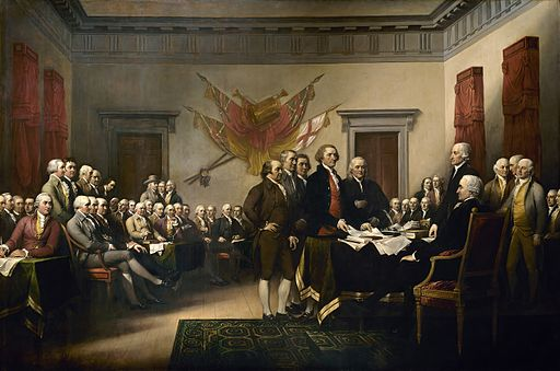 """Declaration of Independence"" by John Trumbull, via Wikimedia Commons. Adams is seated to the viewer's right of Richard Henry Lee, whose legs are crossed in the front row."