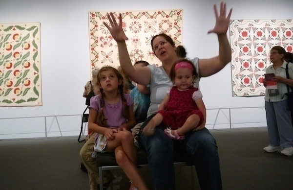Melanie talks to the kids about the patterns found in the quilts at the MFA